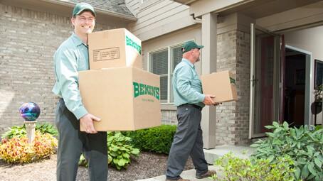 Bekins guys bringing in boxes