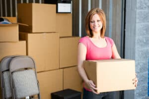 Woman organizing best movers storage unit